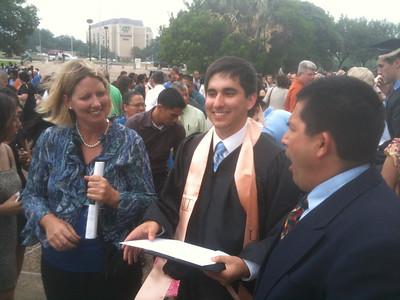 Proud parents Jennifer and Claudio with new grad Alex!