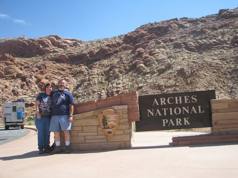 Posing next to Arches entrance sign.