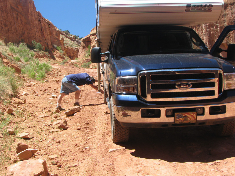 I'm here preparing our truck for its journeyunder the Rock,reducing tire pressure by 25% and all of the air bag pressure.