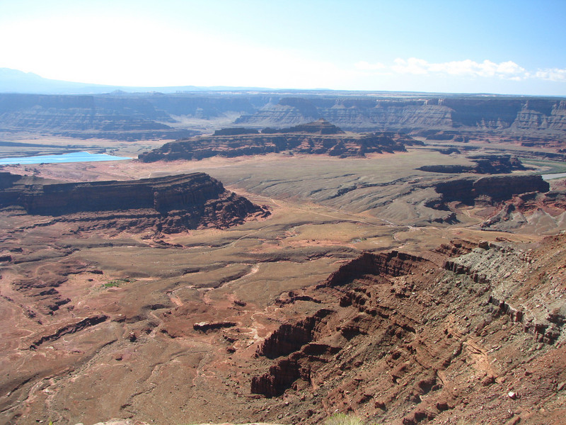Potash Ponds can be seen easily due to its bright blue color in contrast with the surrounding darker soil.
