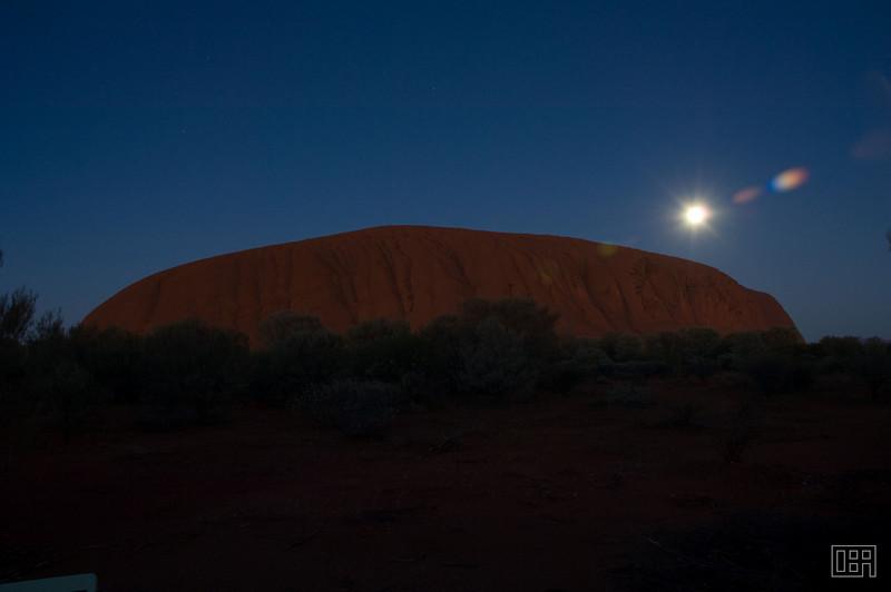 Uluru at sunrise with the Moon