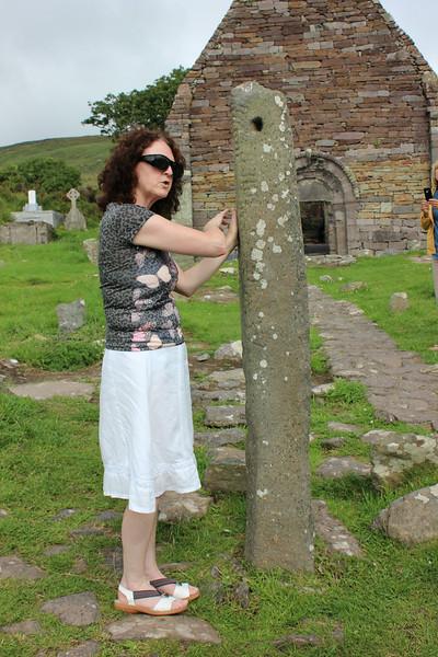 Karen explains to us about the Ogham stone, Dingle Peninsula, Ireland