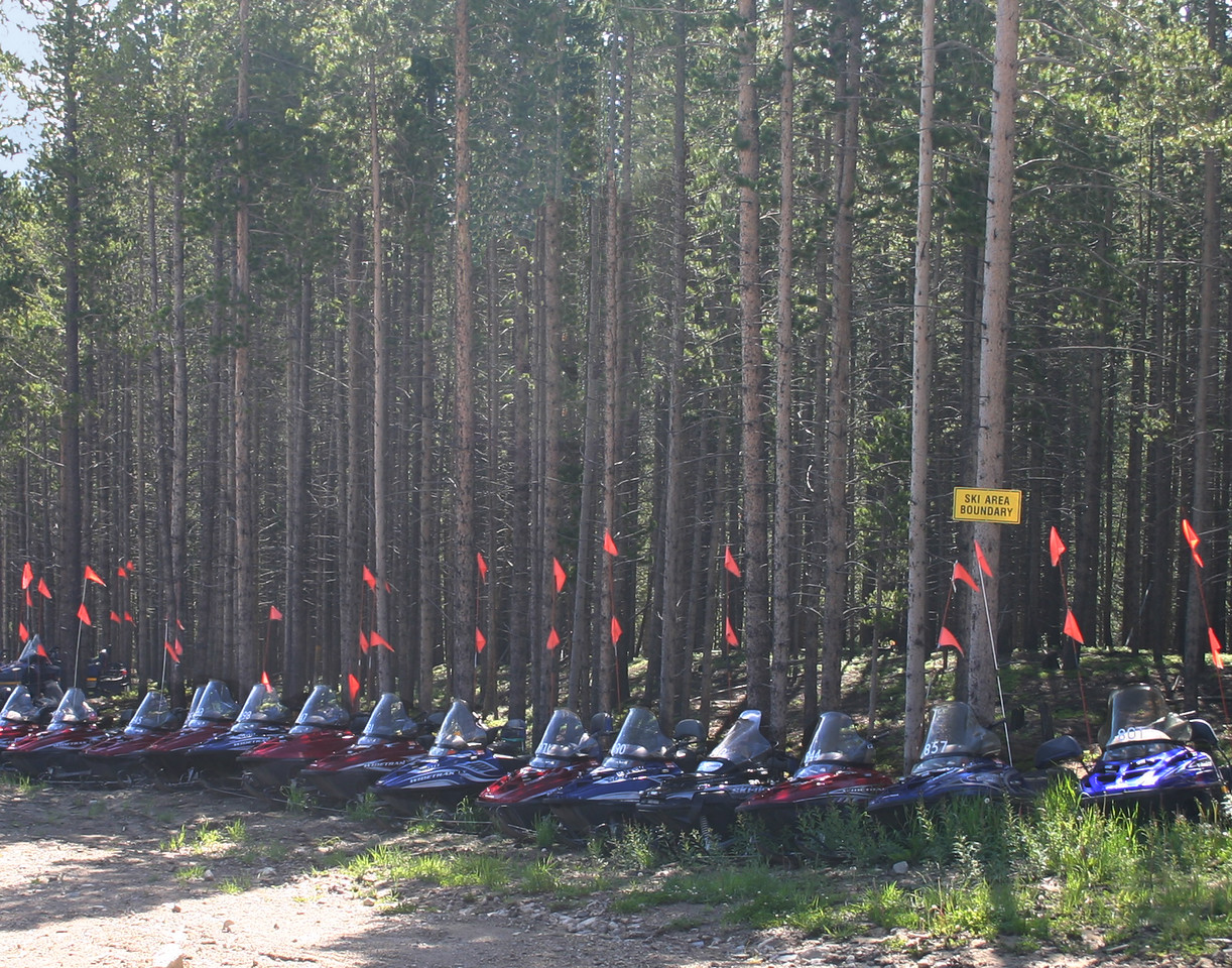 Snowmobiles standing at attention waiting for winter at the Breckenridge Ski Area.