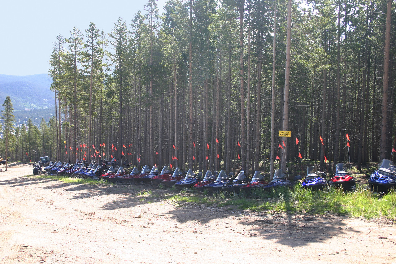 Snowmobiles parked for the summer above the town of Breckenridge.
