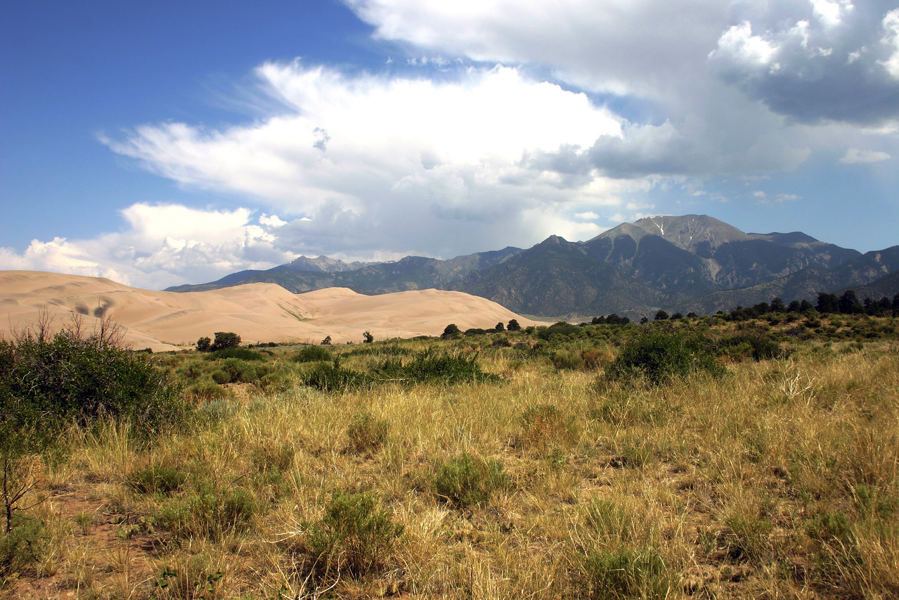 Colorado prairie with Sand Dunes and Sangre de Cristo mountains in the back.