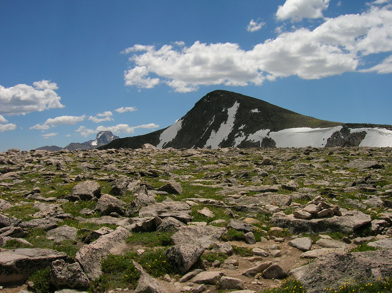 Rocky mountain top and nearby peak