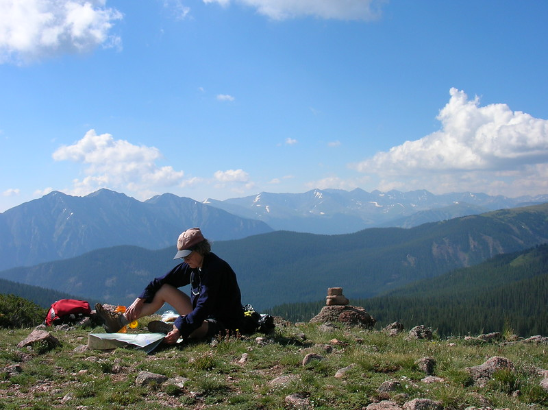 Debby studying map on a hill top. Where do we go next? Another Colorado day!!