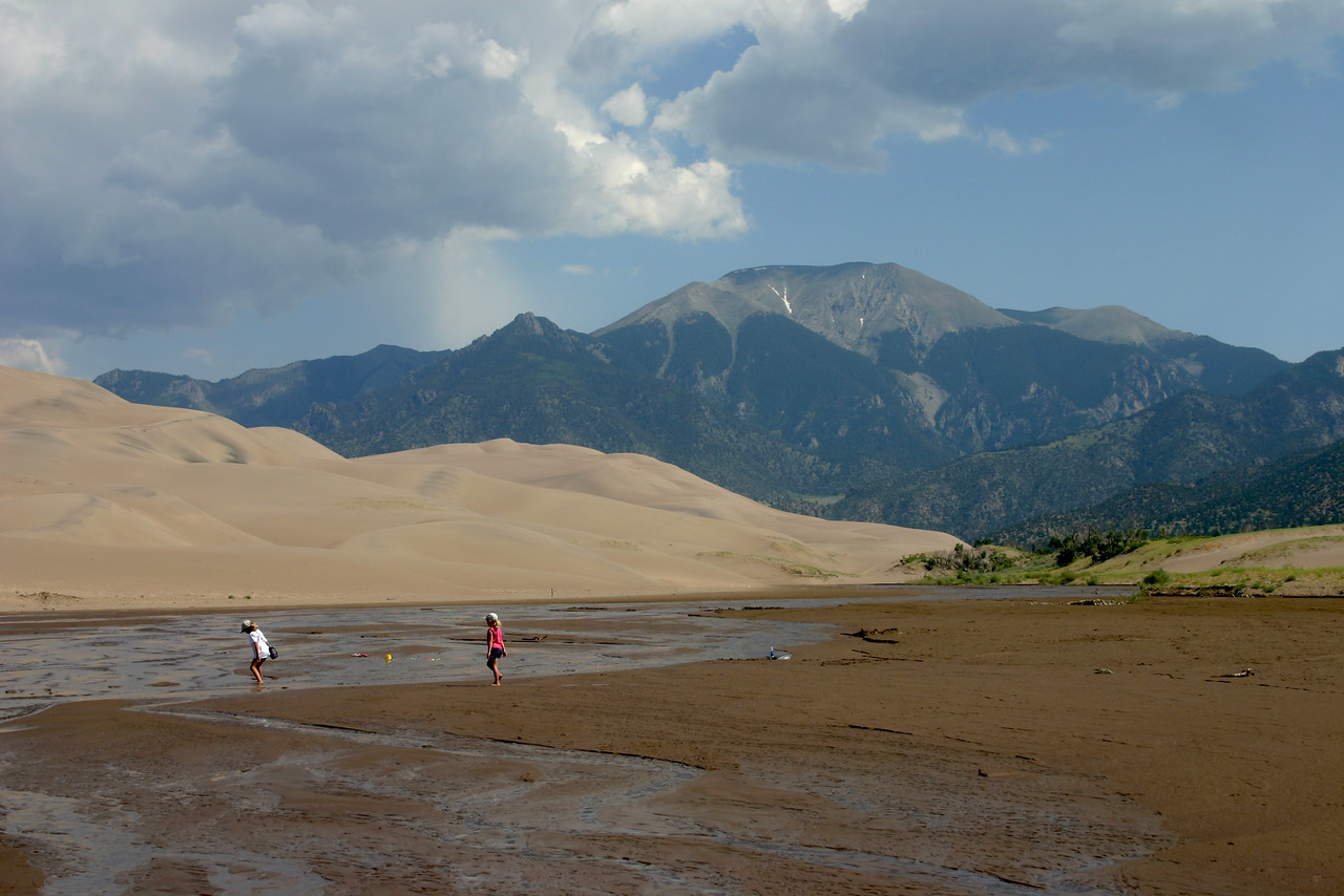 Testing the water in front of the Sand Dunes and Sangre de Cristo mountains