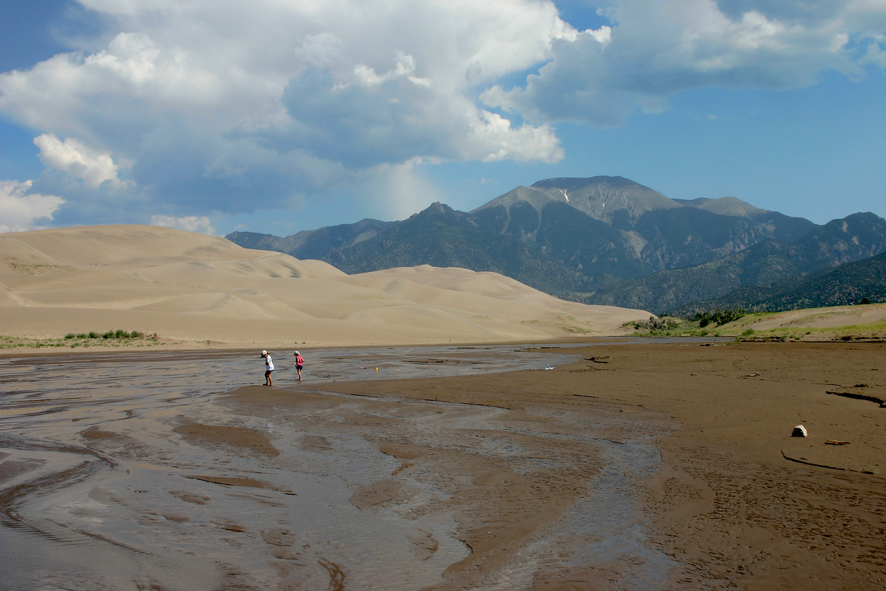 Standing in the stream in front of the Sand Dunes and Sangre de Cristo mountains