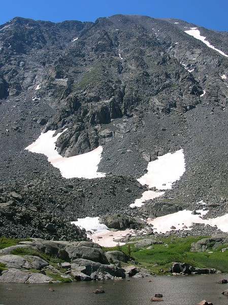 White snow set against the black igneous rock and talus