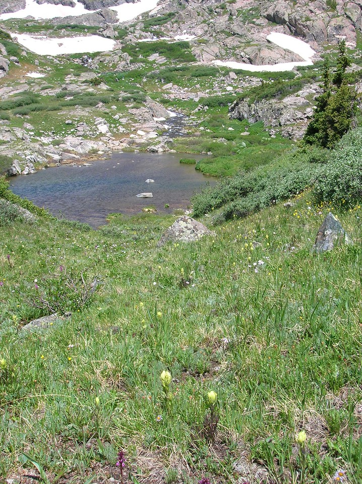 Looking down on the pond in the base of the cirque.