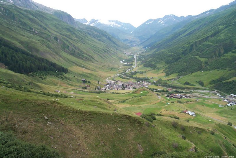 Looking back towards Andermatt - Realp in the foreground.<br /> Notice the odd stretch of straight road.