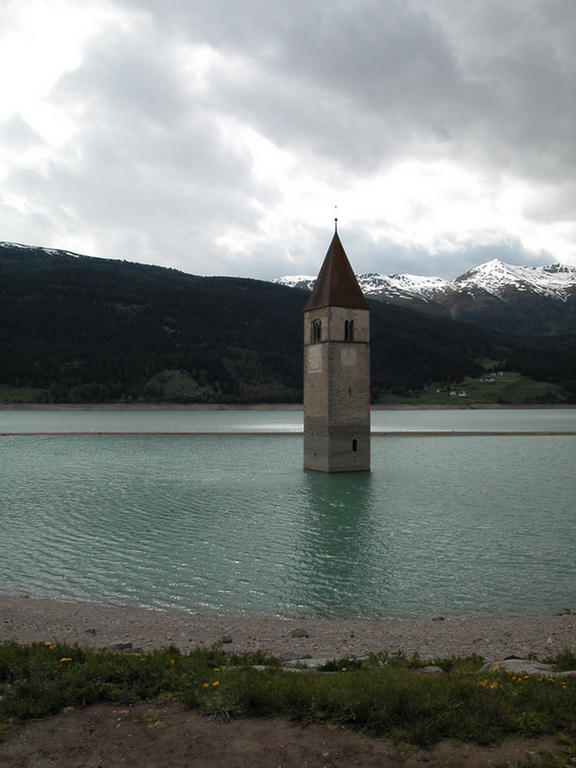 Sole survivor of a drowned town near the Passo di Resia in Italy