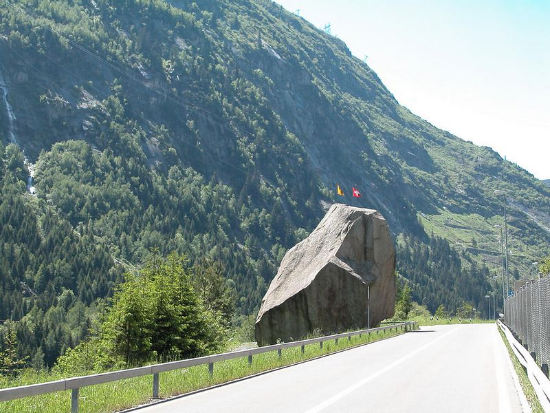 This is THE rock that the devil was going to drop on the bridge. Look up the Teufelbrucke in Andermatt, Switzerland for details.