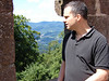 Derek contemplates the forested mountains of the Vosges from Haut-Koenigsbourg.