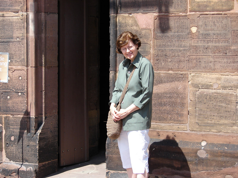 Jeanne on the roof of the cathedral in Strasbourg, France.  The carved graffiti is from the 17th through 19th centuries.