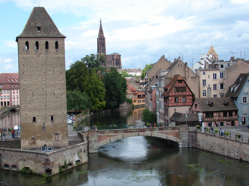 View toward the Cathedral across Le Petite France district of Strasbourg, with a surviving tower from the old fortifications on the left.
