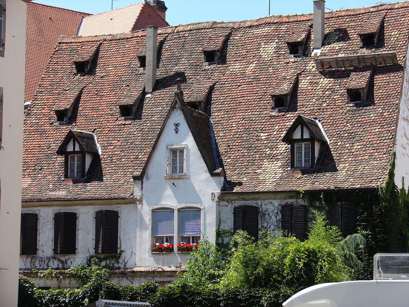 A quaint house in Strasbourg.  I was fascinated by the steep tile roofs with multiple dormers.  They were built that way for storage.  Residents were required to stockpile food in case of siege or military attack.