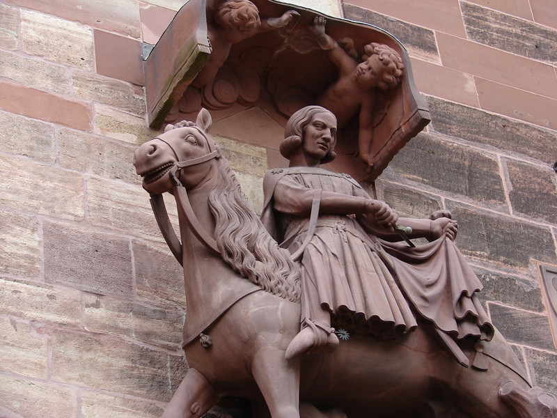 Statuary on the Cathedral in Basel, Switzerland.  Isn't this how we all feel?  In my case, the little angels are about to drop buckets of water.