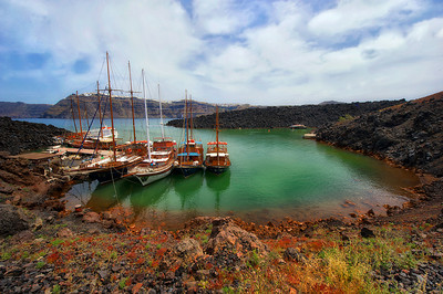 The dock for boats bringing hikers to the volcano. These vessels make about 10 trips each per day. Each boat is stunning in it's craftsmanship, and as clean is if they were launched yesterday. Beware of the hot springs though: we think they're the joke of the island. With the promise of a small cove with 70 degree water, all we found was bone chilling cold. We shivered all the way back to port.
