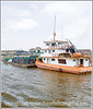 Boats and cargo along the shore of the Amazon River in Peru