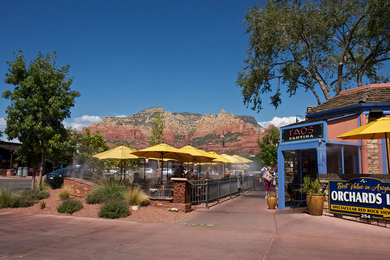 "Sedona, Arizona, surrounded by the ""majestic crimson red buttes, monoliths and spires that have made it famous"""