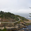 "Highway One from Carmel with road signs warning ""Hills and curves next 63 miles"""