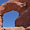 A high flying jet crosses Arches<br /> South Window<br /> Arches National Park