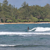 Surfing off Anahola Beach<br /> Kauai