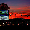 Las Vegas sunset competes with the neon and car lights
