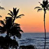 Surfers are out early as the sunrises over Lydgate Park, <br /> Kapaa.<br />  Kauai