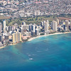 Waikiki beach with its fringe of high rise hotels