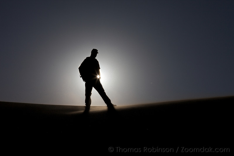 A silhouetted JB braces himself again the wind in the Great Sand Dunes National Park, Colorado.