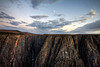 The shines over the Black Canyon National Park from Exclamation Point on the north rim.