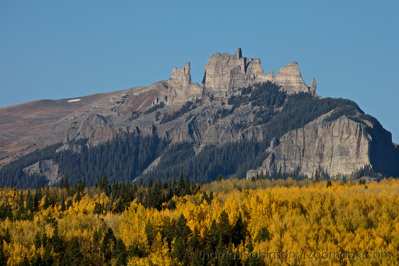 """The Castle"" stands above a forest of aspen trees near Gunnison, Colorado."