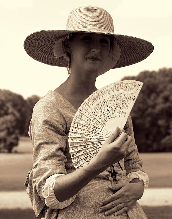 American Village Colonial Belle Fans Herself to Keep Cool During the Heat of Summer