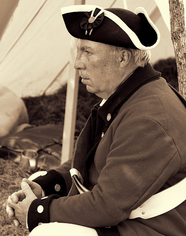 American Village Colonial Soldier Attentive to Battle Briefing