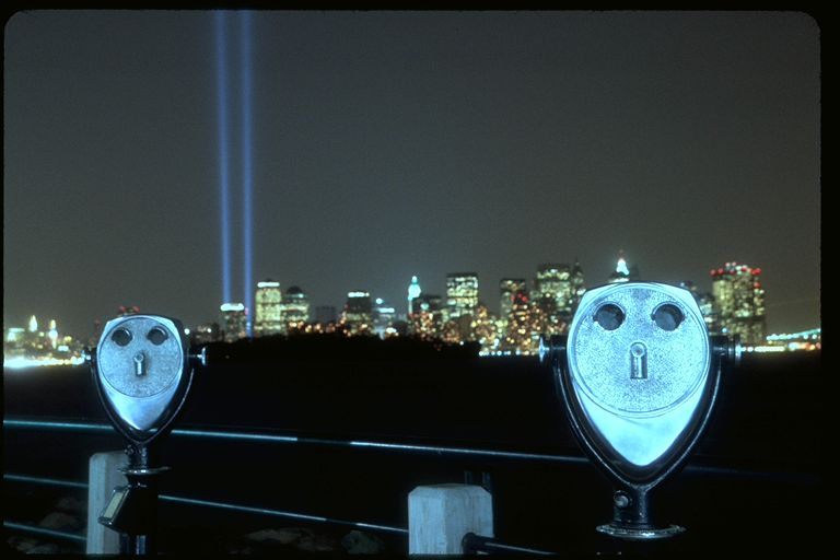 New York City September 11th memorial lights with city binoculars