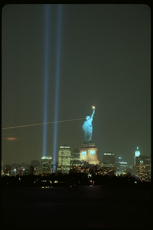 New York City September 11th memorial lights with Statue of Liberty double exposure