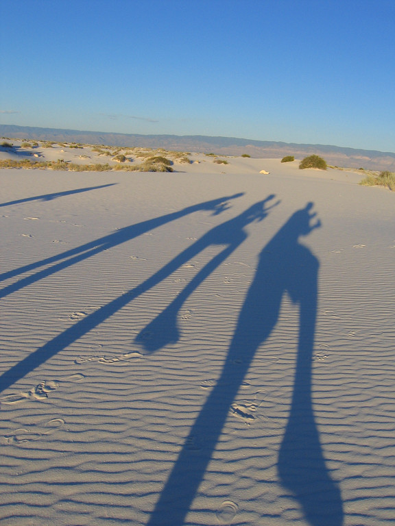 Kokopelli shadows in White Sands, New Mexico