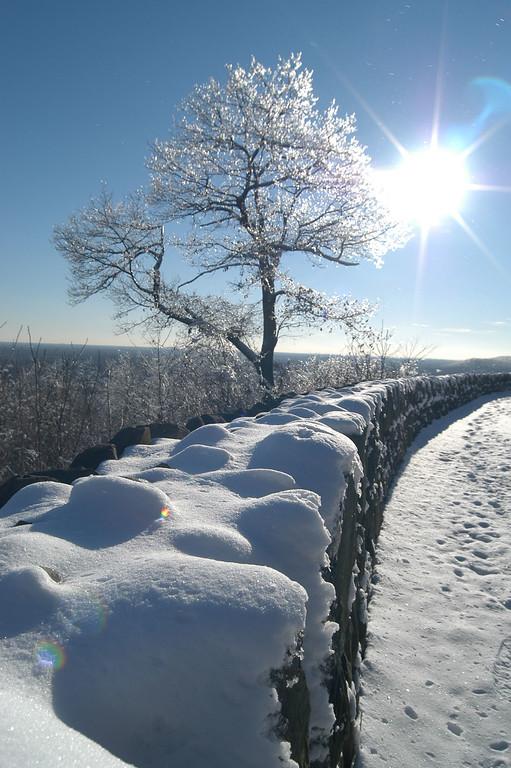 Rock wall winter snowfall in South Orange, New Jersey
