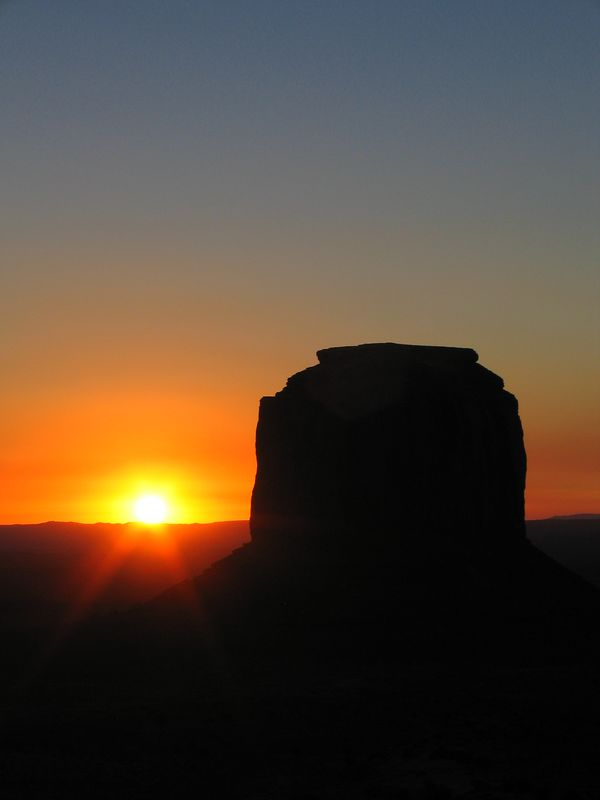 Monument Valley buttes at sunrise, Arizona and Utah vertical