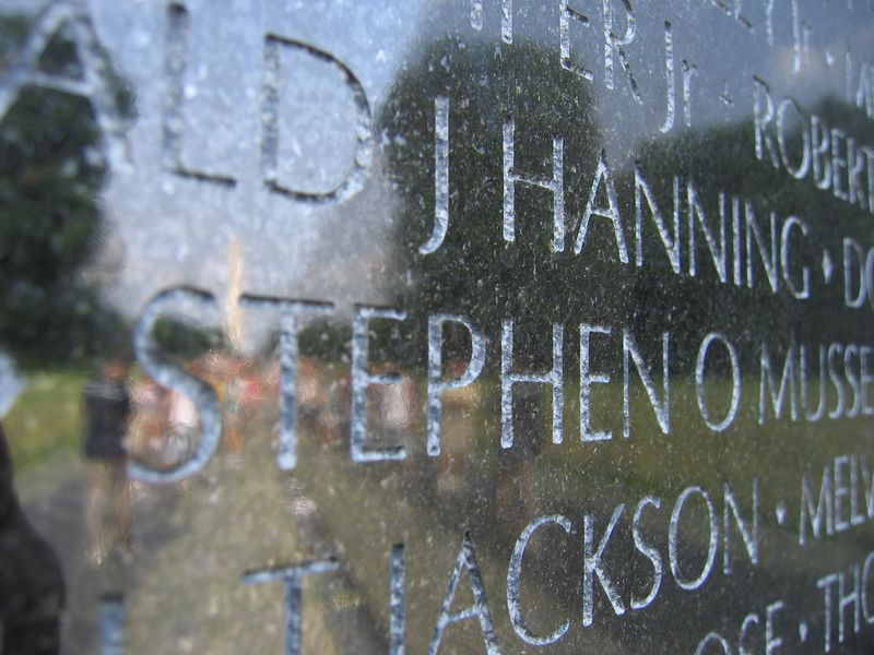 Vietnam Memorial wall with names and reflection in Washington DC