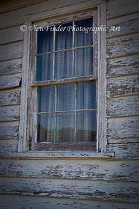 Window on abandoned building at Windsor Castle Farm in Smithfield, VA