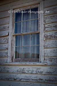 Window on abandoned building at Windsor Castle Farm in Smithfield, VA