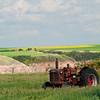 Rusted tractor in Alberta farmfield