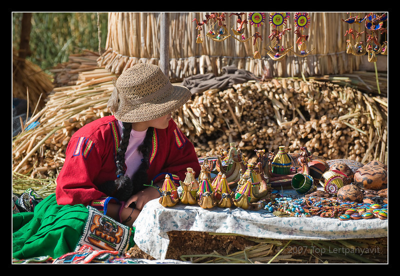 Young Uros lady with display of knickknacks