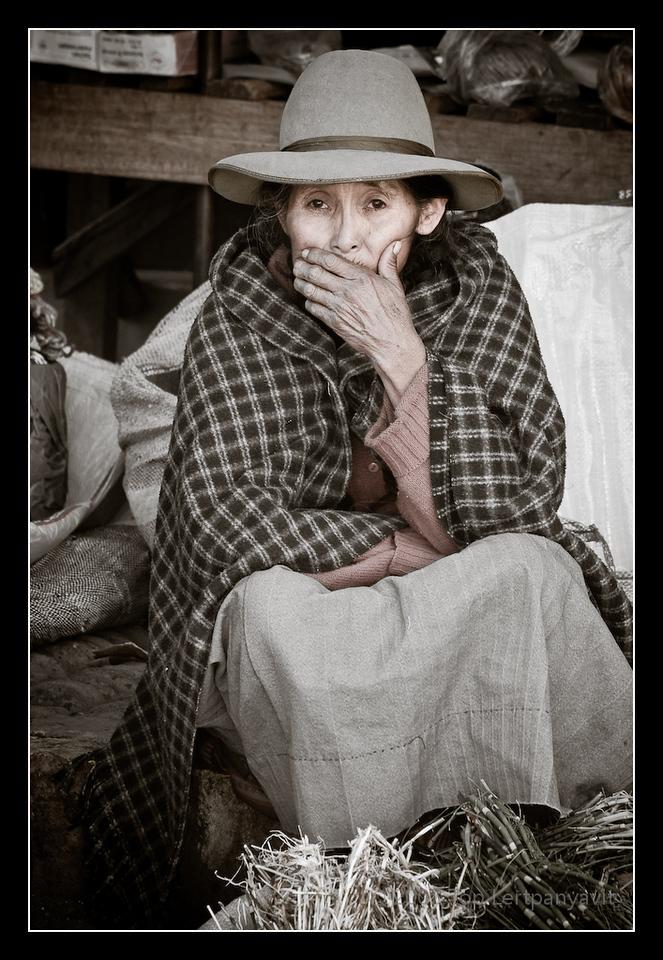 A native Andean street vendor waits for a customer