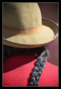 Closeup of back of native Andean street vendor at the Pisac market