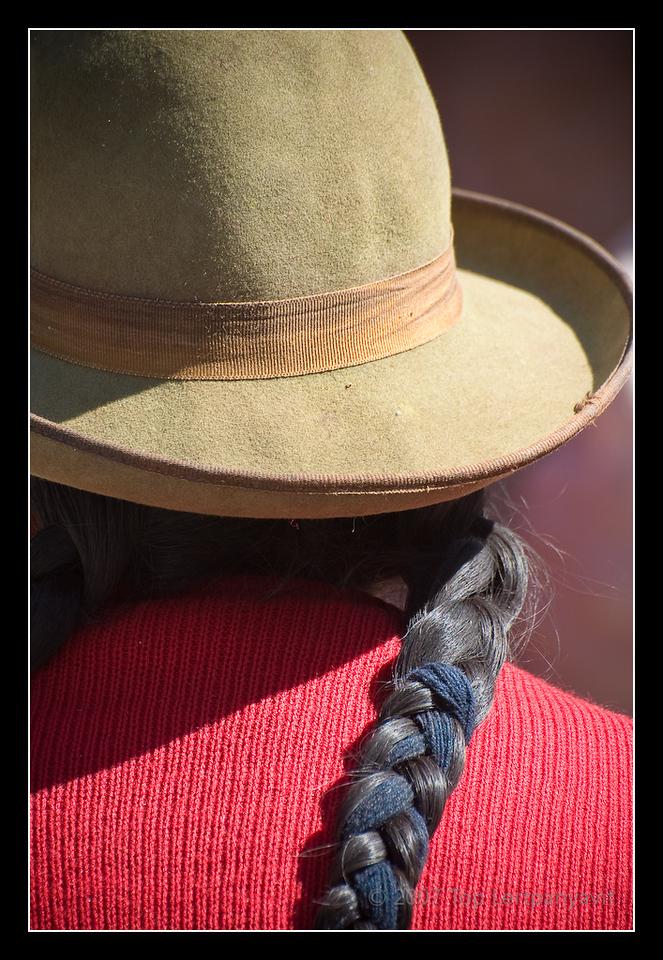 Closeup of back of native Andean street vendor at the Pisac market